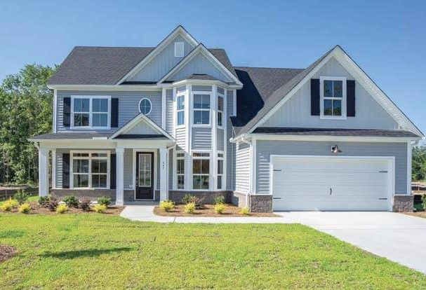 The Norman Plan by Village Park Homes. 2018 St. Jude Dream Home in The Commons in Richmond Hill, GA